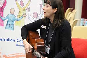 Katherine playing guitar